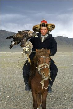 Kazakh eagle hunter.  The practice of hunting with eagles and falcons was almost wiped out by the Soviets who regarded it as a feudal throwback, but thanks to organized eagle-hunting competitions - and a growing interest in Kazakh traditions - the eagle hunters are making a comeback.