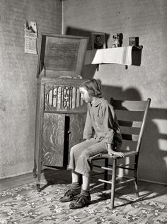 """Listening To Radio, May Crawford County, Illinois. """"Daughter of Farm Security Administration rehabilitation borrower listening to phonograph."""" // by John Vachon for the Farm Security Administration Vintage Pictures, Old Pictures, Old Photos, Retro Images, Antique Photos, Hd Images, Radios, Motif Music, Fotografia Social"""