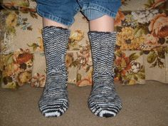 Here is a wonderful pair of hand knit adult size socks. Heel to toe is approx. 9 1/2 in. and the ribbing on the top (top to ankle) is approx. 6 1/2 in. The color yarn used is called Zebra which is a multi- colored yarn that consists of the colors black, gray and white. These socks are made of 100% acrylic yarn and can be machine washed and dried.