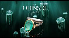 A floating ODINSKI ring surrounded by medusae. Ring is made of fine silver and 22 kt redgold and set with a stunning natural colored Aquamarine