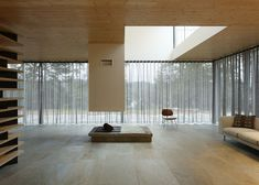 D House with glazed facade and wooden trellis in Brittany, France, by Lode Architecture.