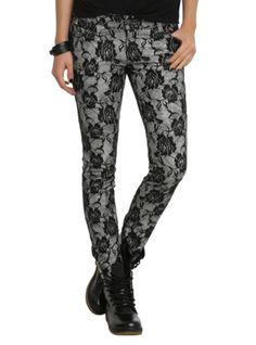 Grey skinny jeans with a black floral lace overlay.