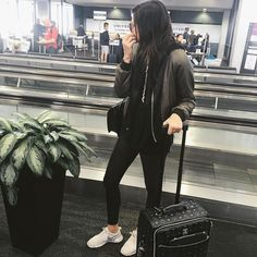 """""""Sunday travel - workout clothes and a bomber jacket #comfortiskey #mcmcarryon"""""""