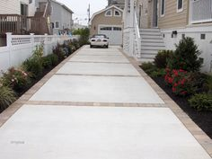 Like Concrete and Paver driveway or concrete with stamped edge instead.