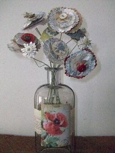 alter an old bottle or even a mason jar with clip art and pages ...
