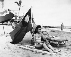Ruth Lee flies a Chinese flag while sunbathing on her day off in Miami - December 15th, 1941