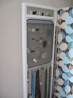 hidden jewelry storage, behind a full length mirror (keeps jewelery organized and out of the way)
