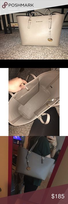 BRAND NEW MK TOTE!! never been used, new MK Jet Set travel Tote! super spacious, cute taupe color! offers accepted, 🙂 no trades please 🚫 Michael Kors Bags Totes