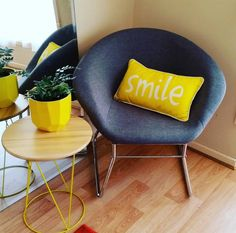 Kmart Homewares Grey Chair with metal legs with sunny yellow accessories styled by the sweet sherbert