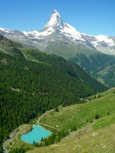 "A glacial tarn with glacial ""milk"" (water from runoff below glaciers) below the Matterhorn peak in the Swiss Alps."
