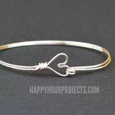 DIY Wire Wrapped Heart Bangle Bracelet at https://www.happyhourprojects.com