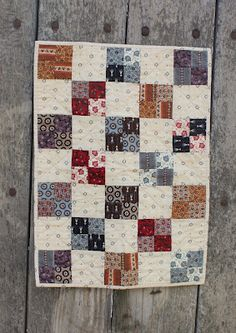 I would scrap and four patch the solid blocks too. Four Patch mini !  Never goes out of style!