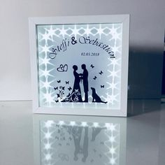 """A beautiful gift for every wedding couple. The image is illuminated with a built-in string of lights. Size of frame 23 x Delivery without battery """"No VAT statement in the invoice (Section 19 UStG)"""". """"VAT will not be shown on invoices (Section 19 UStG)"""". Wedding Picture Frames, Wedding Frames, Wedding Cards, Deep Box Frames, Led Light Box, Diy For Men, Silhouette Cameo Projects, Personalized Wedding Gifts, Pin Collection"""
