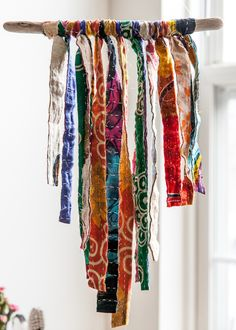 This gorgeous wall hanging is made with driftwood collected on the California coast, adorned with beautiful, colorful vintage kantha. Driftwood length: Approx.