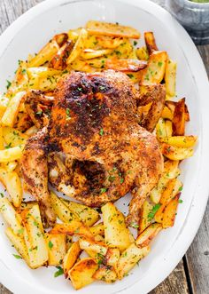 Roast Chicken with Roasted Potatoes and garlic sauce - an all time favorite Sunday supper at my house. A delicious and juicy roast chicken served with perfectly roasted potatoes and an easy garlic sauce that's to die for. Can't get any simpler and more delicious than this.