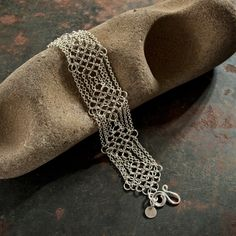 VICTORIAN LACE BRACELET ~ The diamond pattern of this sterling silver, flat chain maille gives this piece a very lacy, feminine look. It also features a handcrafted sterling silver clasp. $208.00 WorldWise Jewelry www.worldwisejewelry.com