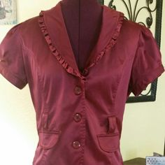 Ashley pink button up top jacket medium Button up short sleeve top or jacket. Small ruffle details around v neck collar. This could be worn alone with camisole or blouse underneath or over a dress. The back of jacket has a slit detsil. Ashley  Tops Blouses