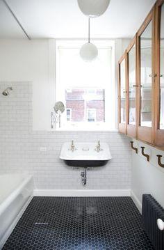 black penny tile, trough sink... subway tile with dark grout. Elizabeth Roberts: Remodelista