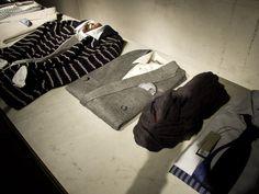Black sweater with white horizontal stripes