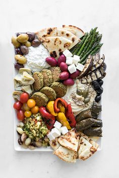 How to Craft a Mezze Board - The traditional Mezze Board is meant to be shared and savoured with a selection of small bites and our version boasts at home classics and simple additions that truly make you feel like youre having tapas in the Mediterranean. Real Food Recipes, Healthy Recipes, Easy Recipes, Healthy Food, Healthy Eating, Tapas Party, Food Platters, Charcuterie Board, Food Photography