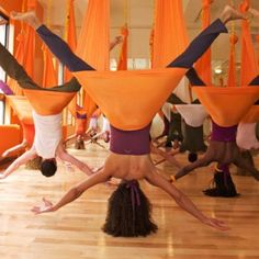 I want to take an anti-gravity yoga class. It looks more than a little fun and plain impressive.....omg I wanna be a loop dancer