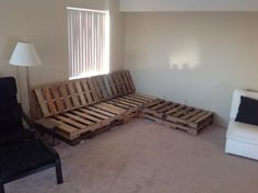 Diy pallet couch with chaise lounge. Cushions are in production.