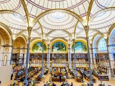 Library. Mid 19th-Century Reading Room at Bibliotheque Nationale, Paris. Restored and inauguerated as library of the Institut National d'Histoire de l'Art. Architect: Henri Labrouste.