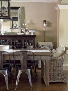 Keep it interesting with a mix of metal and wicker chairs, reclaimed lumber table, use plug-in wall sconces to add more lighting ---Anisa Darnell