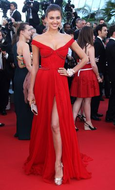 22.5.12  #Cannes 12 Irina Shayk flashes some leg in a sexy off the shoulder gown and metallic accessories. #HauteCouture #RedCarpet