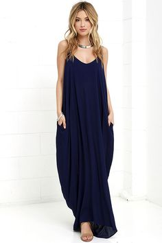 Lulus Exclusive! Every flower in the garden won't compare to you in the Garden Charmer Navy Blue Maxi Dress! This simple, gauzy rayon maxi has a relaxed triangle bodice, adjustable spaghetti straps, and hidden front pockets on a breezy, Boho skirt.