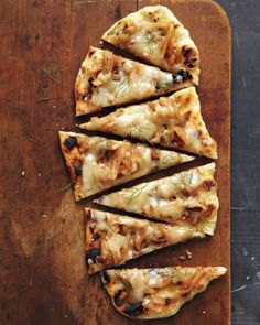 Fontina, Fennel, and Onion Pizza (Keep the heat outdoors with this grilled pizza topped with sweet fennel and onions. No grill? No problem. Cook this dough in a cast-iron skillet over high heat, or on a preheated sheet pan or pizza stone in a 500-degree oven.)