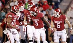 Teammates including Baker Mayfield (right) congratulate CeeDee Lamb following a touchdown pass during the second half of a college football game in which the University of Oklahoma Sooners (OU) defeated the Texas Tech Red Raiders 49-27 at Gaylord Family-Oklahoma Memorial Stadium in Norman, Okla., on Saturday, Oct. 28, 2017. Defender Jah'Shawn Johnson was hit with a targeting penalty on the play. Photo by Steve Sisney, The Oklahoman
