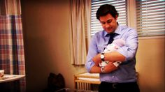 one million times hotter with a tiny human in his arms!