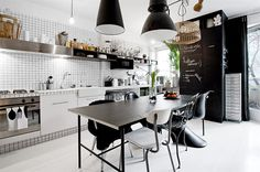 Black and white kitchen in a small studio apartment in Sweden.