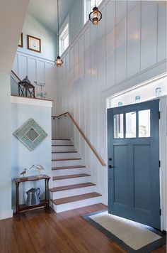 Board and batten foyer. A foyer with board and batten walls, painted in…