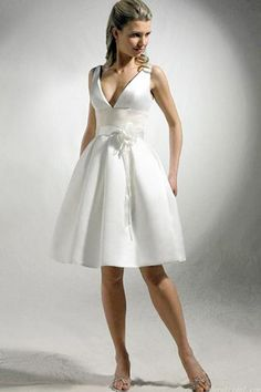 A sexy white taffeta short wedding dress fits for garden, beach, yacht and other outdoor wedding. The designer wedding dress features a deep v-neckline and hand-made flower decorated empire waistline. Zipper up sexy v-shaped back. ( Note: Only dress included in original sell, veil, necklace and other accessories not included ) $98.00