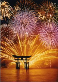 Miyajima water fireworks -- Japan Fireworks display be held in offshore Itsukushima (嚴島) shrine. Fireworks in water open to the silhouette of a torii is a fireworks display to represent our country.
