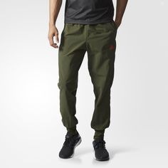 Your workout can breathe easy with these men's pants. They're made with climacool® ventilation and feature tapered legs and water-repellent fabric on the front.