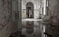 Wet hallway in abandoned asylum for the criminally insane