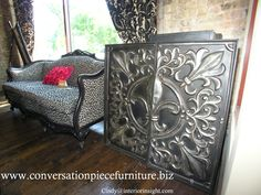 """Fluer De Lis wall sculpture and French Provincial Cheetah print sofa  These ladies have closed their store but the pictures are still great """"ideas"""" for anyone upcycling old pieces!"""