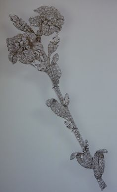 """The Queen Mother`s Lily or """"Foot Long"""" brooch. Inherited by the Queen in 2002. In the form of a stem of lilies, with two open flowers, claw & pave-set with brilliants & with 6 pear-shaped diamonds forming buds. The brooch was made by Cartier in London 1939 using diamonds already owned by the Queen."""