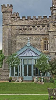The conservatory added to this castle features a solid timber gable and an octagonal leaded bay extension. Fan lights are bronze casements.