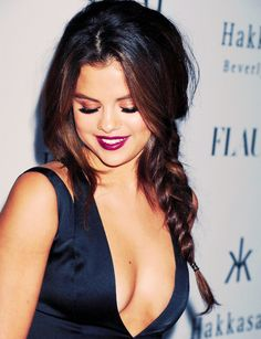 Selena Gomez's braid and dark red lipstick are perfect for a holiday party