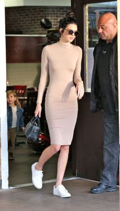 16 monochromatic neutral outfit ideas to take from the most stylish celebrities: Kendall Jenner wears a nude dress with white sneakers