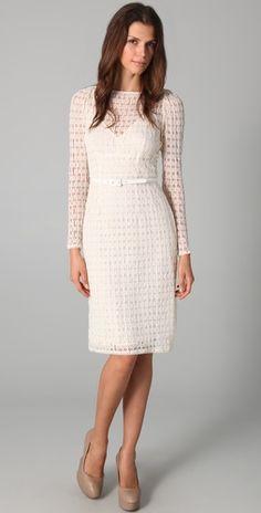 A great waist-defining dress. Love the nude pumps.