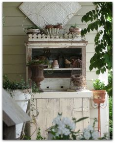 White cupboard on porch
