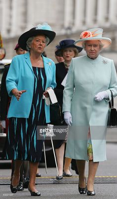 Britain's Queen Elizabeth II and Baroness Boothroyd of Sandwell arrive for the unveiling of the Monument to Women in World War 2 on July 9 in London, United Kingdom. British Monarchy History, Rubber Raincoats, House Of Windsor, Her Majesty The Queen, Save The Queen, Queen Elizabeth Ii, Coat Dress, British Royals, World War Ii