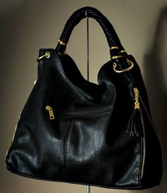 Every woman should have a black purse in her closet. This black hobo bag has eye-catching tassels and gold hardware for a fun trend update.
