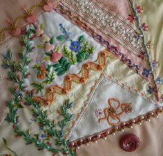 Crazy Quilt block from Pin Tangle. Beaded embroidery with hankies.