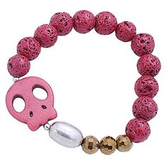 The featured bracelet showcases a magnesite rock cartoon skull, a brass bead, disco ball beads, and lava rocks strung together as a very fashionable bracelet.